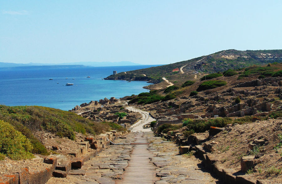 Archeology Beauty In Nature Blue Boardwalk Clear Sky Coastline Curve Day Footpath History Long Mountain Narrow Nature No People Outdoors Pathway Scenics Sea Sky Tharros The Way Forward Walkway Water