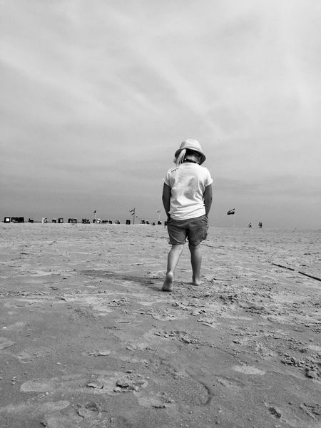 I'm walking. Rear View Full Length Real People Sand Beach Leisure Activity One Person Casual Clothing Walking Sea Lifestyles Sky Standing Day Nature Outdoors Women Vacations Beauty In Nature