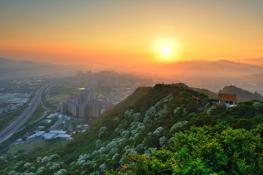 Early morning sun, full of warm hope. Beautiful City Taiwan's New Taipei City Fugueijiao Lighthouse Three Gorges Architecture Beauty In Nature Building Exterior Built Structure City Cityscape Dawn Day High Angle View Morning Fog Nature No People Orange Color Outdoors Scenics Sky Sunrise Sunset Tree Tung Blossom Warm