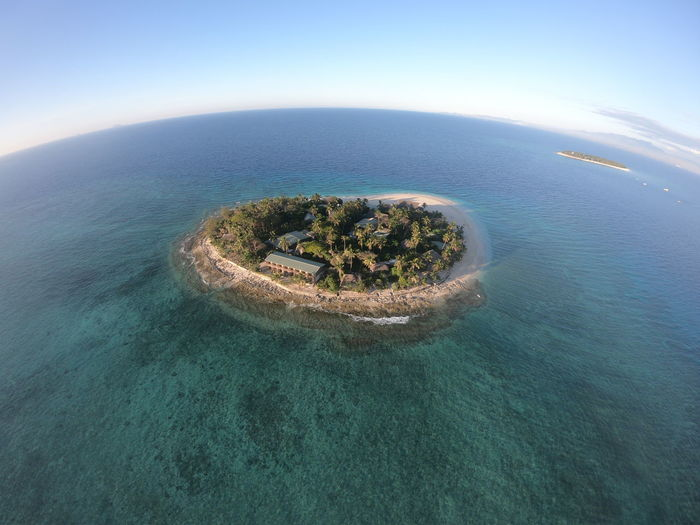 High Angle View Of Island Amidst Sea Against Sky