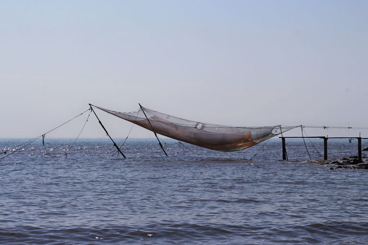 Fishing Net Beauty In Nature Clear Sky Day Fishing Horizon Over Water Nature No People Outdoors Scenics Sea Sky Water Waterfront