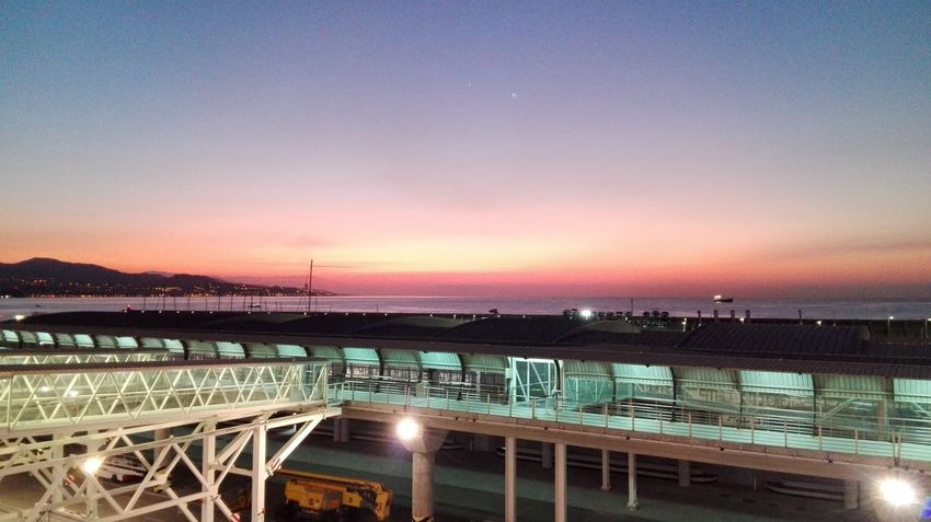 Night Sunset Sky Bridge - Man Made Structure Illuminated City Rollercoaster Outdoors Water No People Sea Architecture Cityscape Star - Space Clear Sky Urban Skyline Astronomy Milky Way Galaxy Nature