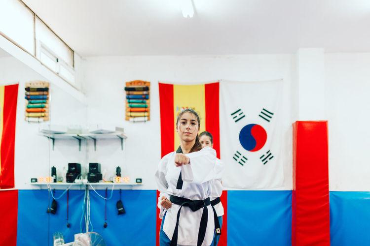 Woman practicing karate at health club
