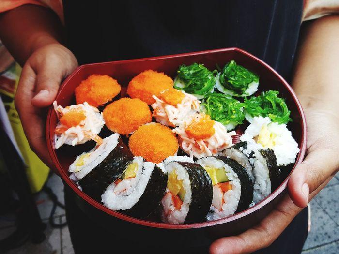 Sushi on Hand EyeEm Selects Human Hand Egg Yolk Fried Egg Holding Bowl Egg Close-up Food And Drink Sushi Japanese Food Soy Sauce Tuna Seafood Sashimi  Rice - Food Staple Korean Food Salmon Boiled Egg Chopsticks Prawn Shrimp Shrimp - Seafood Japanese Culture Salmon - Seafood