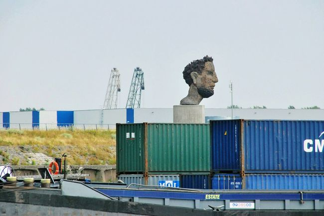 Poseidon is greeting No People Harbour Cruise Lüpertz Statue River Rhein Ships Container Container Ship Blue Green Yellow Cranes Face Water Sky Building Urban Scene