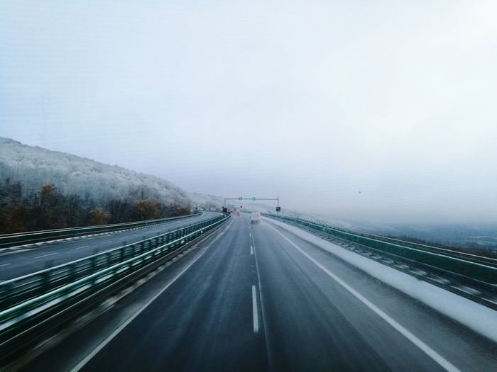 Highway against sky during winter