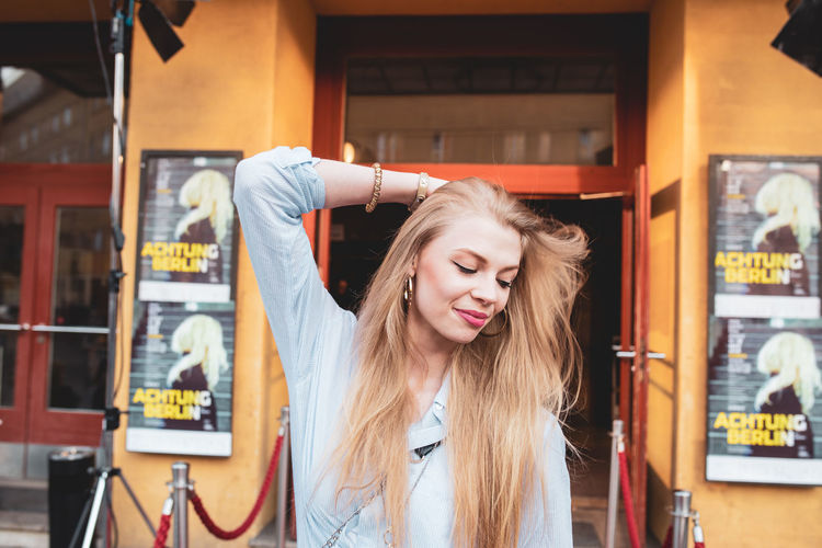 Beautiful Woman Standing Against Store