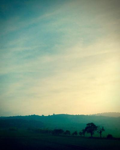 Silhouette landscape against mountain range