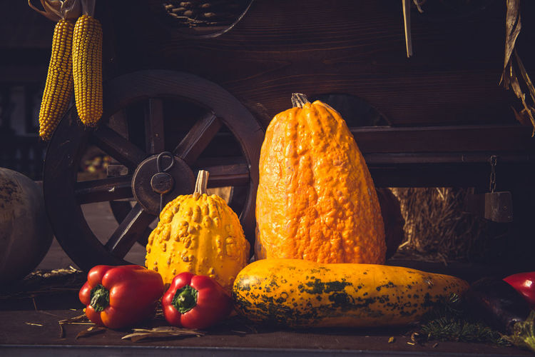 Autumn harvest. Vintage cart full with freshly picked vegetables Autumn Bio Harvest Season Wheel Arrangement Cart Corn Harvest Fall Filtered Food Food And Drink Freshness Harvest Harvesting Healthy Eating No People Organic Pumpkin Still Life Toned Vegetable Vintage Vintage Wooden Cart Yellow