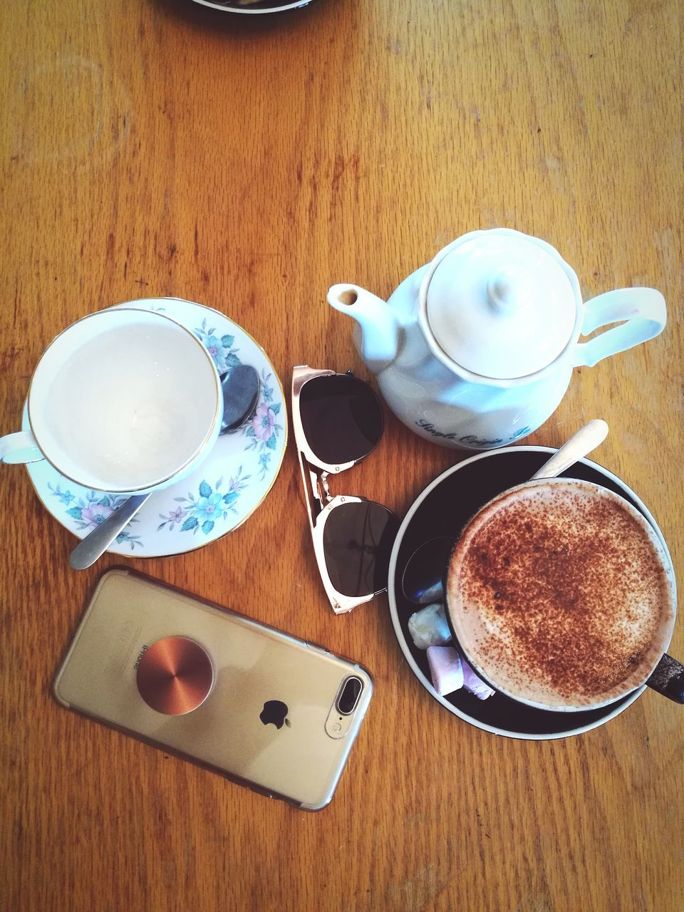 food and drink, table, drink, coffee cup, refreshment, high angle view, indoors, coffee - drink, no people, wood - material, freshness, frothy drink, food, day, close-up