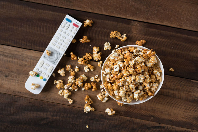 popcorn on wooden table background Family Homemade Natural Light Popcorn Snack Aroma Background Bowl Caramel Cinema Day Eat Flavored Food Gourmet Lifestyles Movıe No People Pile Sweet Table Treat Tv Remote Wooden Yellow