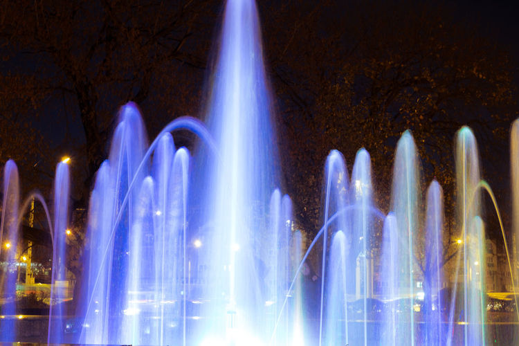 Panoramic view of illuminated fountain at night