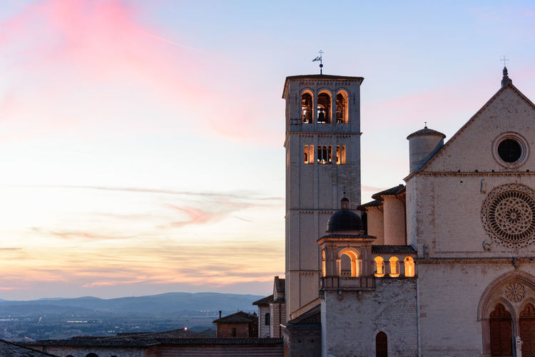 Basilica Of San Francisco In Assisi Against Sky During Sunset