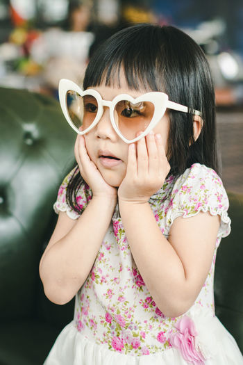 Bangs Casual Clothing Child Childhood Fashion Females Floral Pattern Focus On Foreground Front View Girls Glasses Hairstyle Innocence Leisure Activity Lifestyles One Person Pink Color Portrait Real People Sunglasses Women