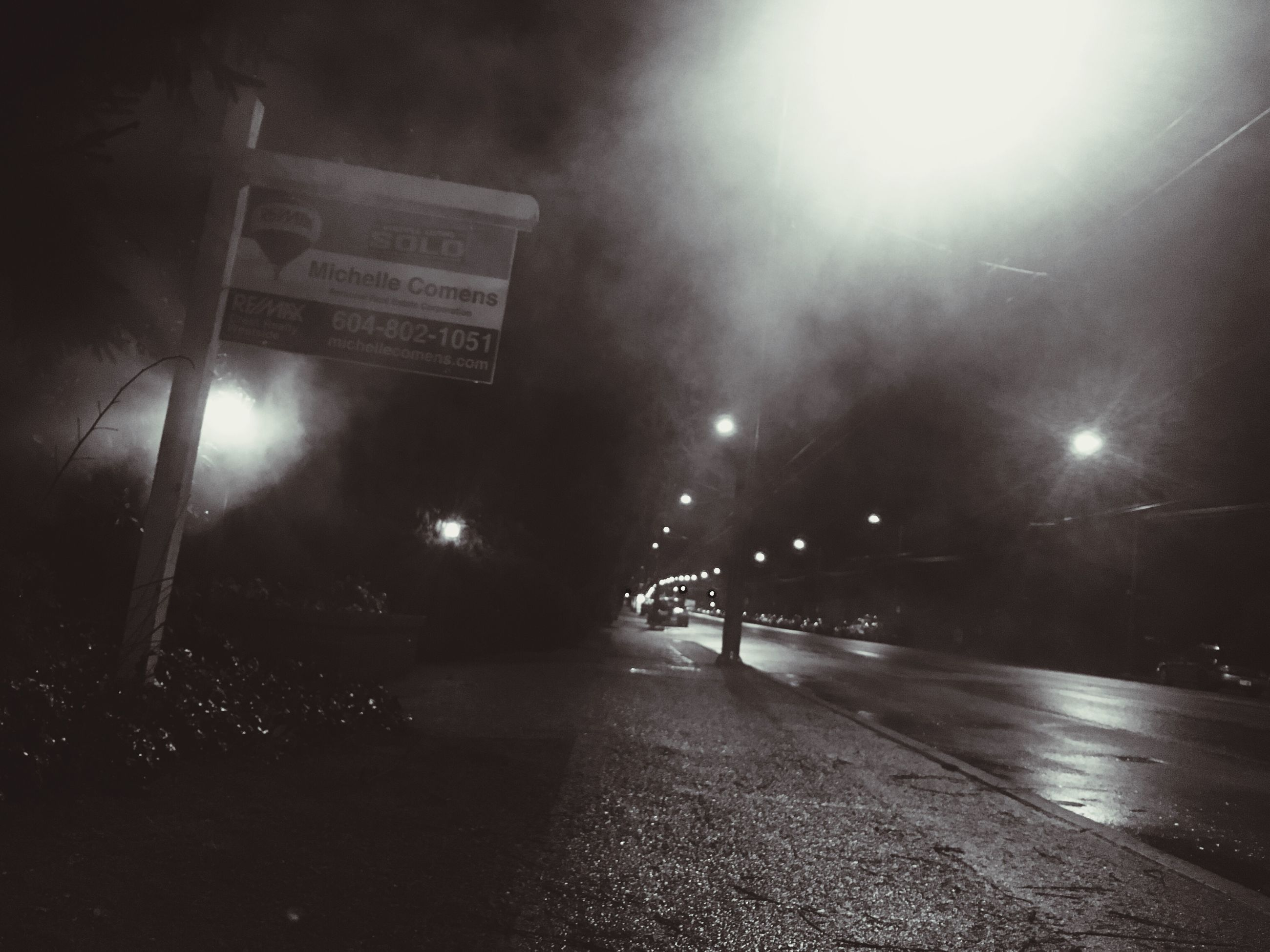 night, illuminated, transportation, the way forward, street light, road, street, lighting equipment, diminishing perspective, road marking, car, on the move, vanishing point, one person, mode of transport, land vehicle, walking, built structure, outdoors, architecture