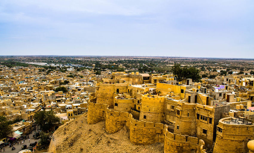 Jaisalmer Cityscape from top of the Fort Architecture Building Exterior Built Structure Nature Cityscape No People Sky Outdoors Day Jaisalmer Jaisalmer Fort Jaisalmer City Cityscape Breathtaking Thar Desert Golden Hilltop Historic Landscape Maharaja Sandstone Tourist Destination Travel Destinations Yellow Blue Sky Clouds And Sky Living Fort