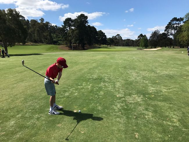 Hole in one Fairway On Golf Course Junior Golf Grass Plant Leisure Activity Real People Green Color Tree One Person Sport Golf Childhood Lifestyles