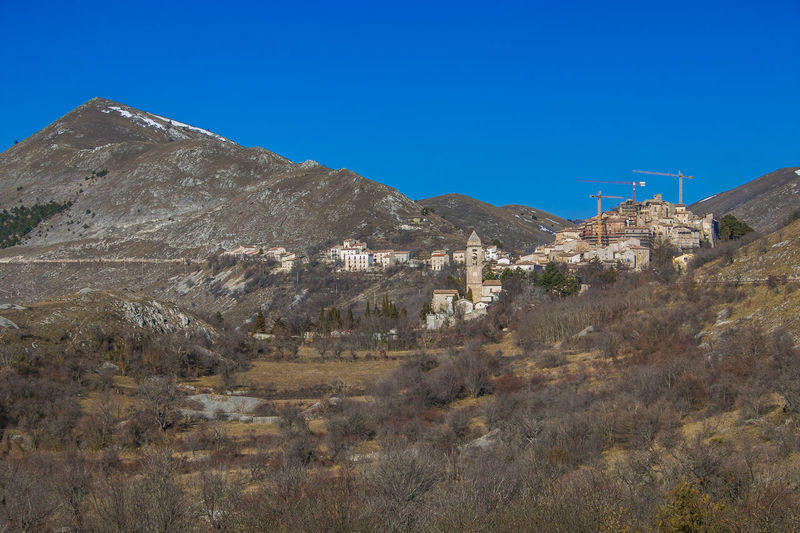 Panoramic view of Santo Stefano di Sessanio dstroyed by earthquake of l'Aquila in Abruzzo Earthquake Abruzzo Santo Stefano Di Sessanio Earthquake L'aquila Italy Village Mountain Nature Architecture Medieval Church Gran Sasso D'Italia Monti Della Laga Historic Street Card Wallpaper Desktop Backgrounds Panorama Scenics Sky Blue Built Structure Building Exterior Environment Landscape Plant Scenics - Nature Clear Sky Day Land Copy Space Building Beauty In Nature Tranquility Tranquil Scene No People Mountain Range Outdoors