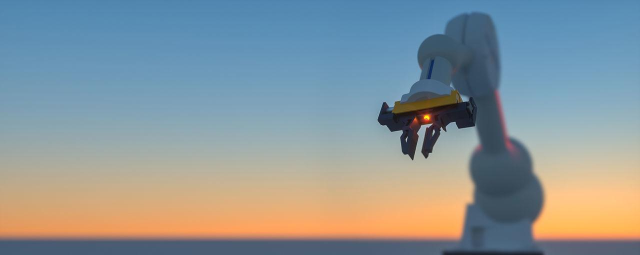 Illuminated machinery against sky during sunset