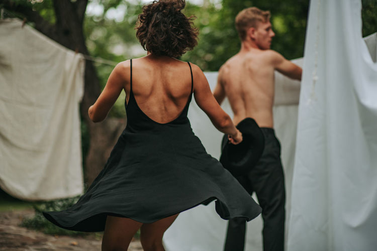 Rear view of couple standing outdoors