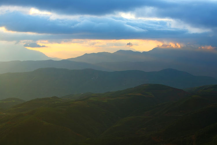 Beautiful landscape of mountain range with sunrise light in dongchuan of China Mountain Scenics - Nature Sky Beauty In Nature Cloud - Sky Tranquil Scene Tranquility Environment Landscape Mountain Range Non-urban Scene Idyllic Sunset No People Nature Majestic Outdoors Fog Remote Mountain Peak China