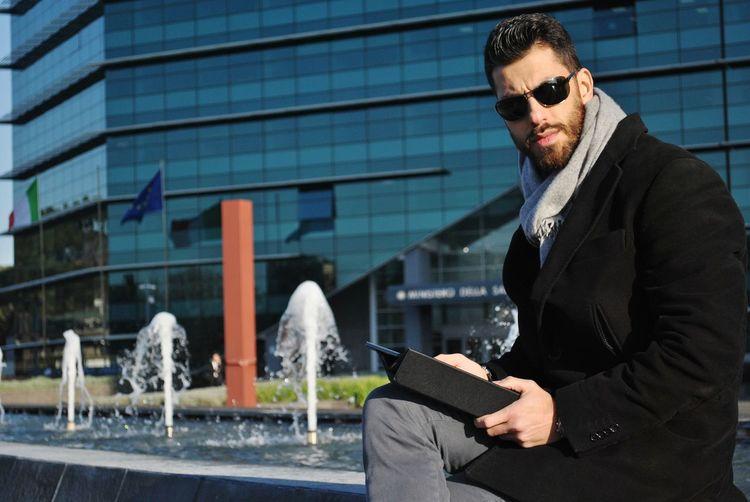 Handsome businessman holding digital tablet