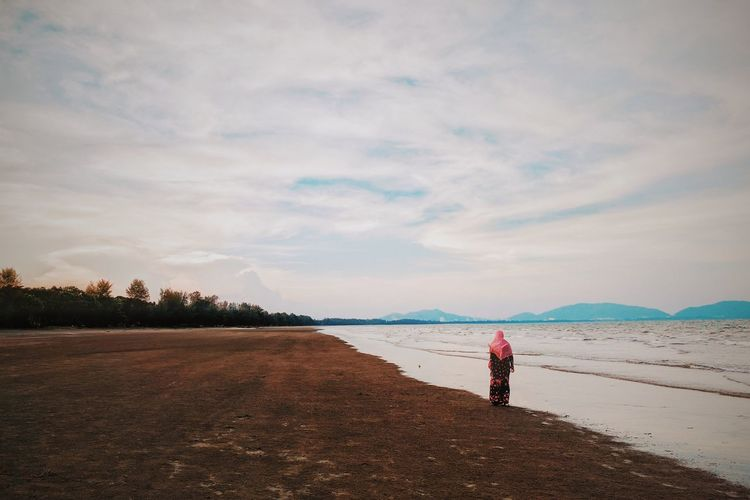 Beach Full Length One Person Sand Sky Standing Cloud - Sky People Sea Adult Only Women Adults Only One Woman Only Mature Adult Water Horizon Over Water Walking Day Vacations Outdoors TCPM EyeEm Nature Lover POTD Scenics Bestoftheday Break The Mold TCPM