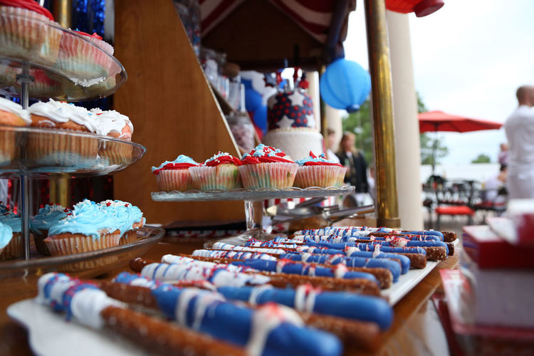 Fourth of July themed candy, cupcakes and red, white and blue treats on a cart in the summertime. Horizontal image. Blue Candy Cart Celebration Concept Cupcakes Event Fourth Of July Independence Day Pretzel Red Summer Summertime Treats White EyeEmNewHere