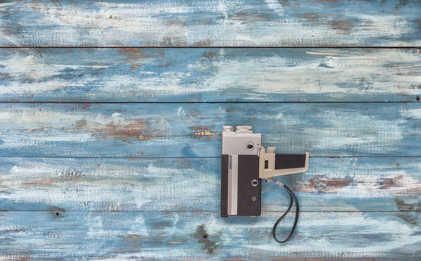 Close-Up Of Camcorder On Wooden Table