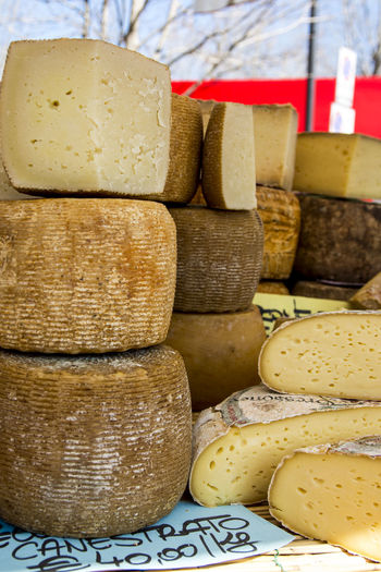 Stacked cheese for sale at market stall