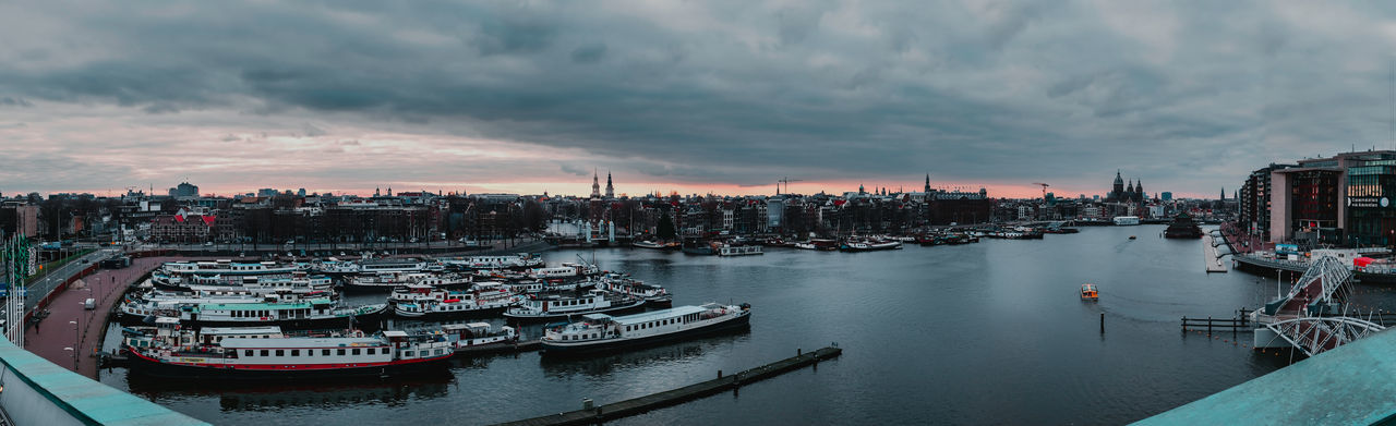 Panorama of Amsterdam City, Netherlands Architecture_collection Holland Netherlands Amsterdam Water Reflections Amsterdam Canal Water City Street Cityscape Urbanphotography Nautical Vessel Mode Of Transportation Harbor Sunset Sailboat Outdoors