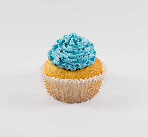 Lemon Cupcake Blue Cake Close-up Copy Space Cupcake Dessert Food Food And Drink Freshness Frosting Indoors  Indulgence Lemon Multi Colored No People Product Product Photography Ready-to-eat Studio Shot Sweet Food Temptation White Background