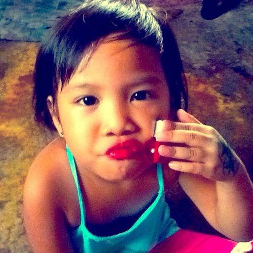 Lippy on... Nicole with her lipgloss. ?? Lippy Liptint Lipgloss Princess kikay kiddo babygirl littlekikay kikayprincess odbo fab