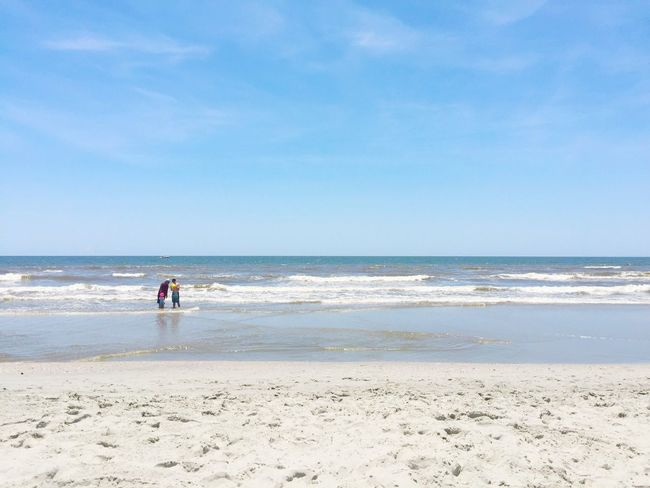 Beach vacation summer daytime ocean family father kids playing