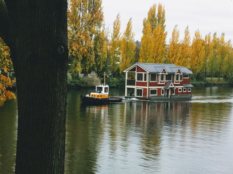 Towing Beauty In Nature Built Structure Canal Day House Boat Houseboat Lake Nature Nautical Vessel No People Outdoors Scenics Sky Tranquility Transportation Tree Water Waterfront