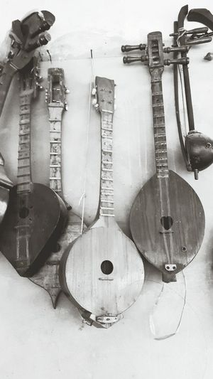 Music Musical Instrument Guitar Indoors  String Instrument Electric Guitar Hanging Arts Culture And Entertainment Wood - Material Workshop Bass Instrument No People Work Tool Musical Instrument String Instrument Maker Day Repair Shop Close-up