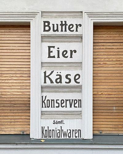 Text on closed wooden door of building