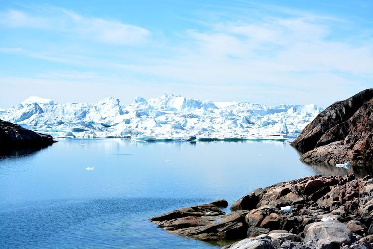 Ilulissat, Greenland, July | UNESCO world heritage site | impressions of Jakobshavn | Disko Bay Kangia Icefjord | huge icebergs in the blue sea on a sunny day | climate change - global warming Beauty In Nature Nature Outdoors Icebergs Iceberg Greenland Climate Change Global Warming UNESCO World Heritage Site Arctic Melting Glacier Natural Beauty Cold Temperature Day Summer Tranquility Nordic Scenery Tranquil Scene Scenics - Nature No People Hikingadventures Travel Destinations Outdoor Photography Outside