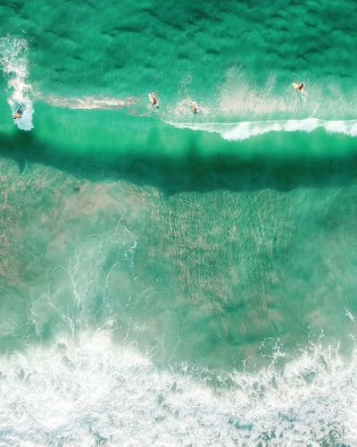 Aerial view of people surfing in sea