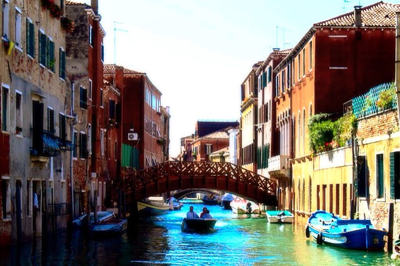 architecture, building exterior, built structure, nautical vessel, transportation, travel destinations, day, outdoors, canal, old town, gondola - traditional boat, no people, city, water, sky