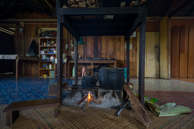 The hearth is centre of life, its where meals are cooked based on rice for Kelabit. Kelabit longhouses are made up of row of hearths, each belonging to one family. BARIO Architecture Barn Built Structure Day Fireplace Flame Hearth Heat - Temperature Indoors  Longhouse Mammal No People Wood - Material