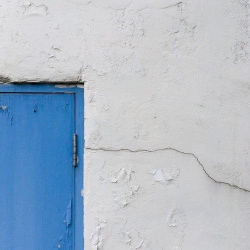 Architecture Blue Building Exterior Built Structure Close-up Cracked Door Iron Natural Light No People Outdoors Streetphotography Textured  Wall White