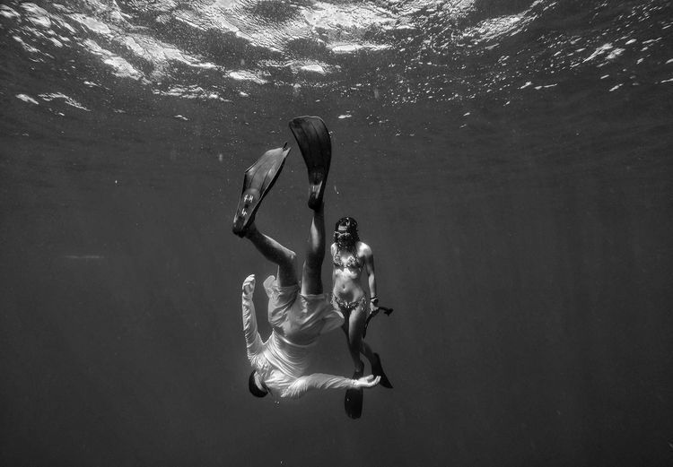 Man and woman swimming in sea