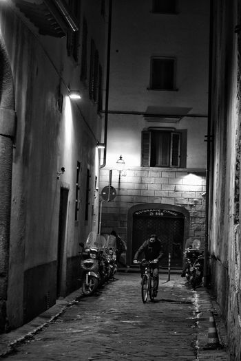 Florence Street By Night Built Structure Transportation Bicycle Night Building Exterior Illuminated Shadow Full Length Lifestyles Winter City Casting A Shadow Shadows Shadows & Light Black And White Monochrome The Best City In The World Florence Florence Italy Travel Street Photography Contrast Outdoors Street Mystery