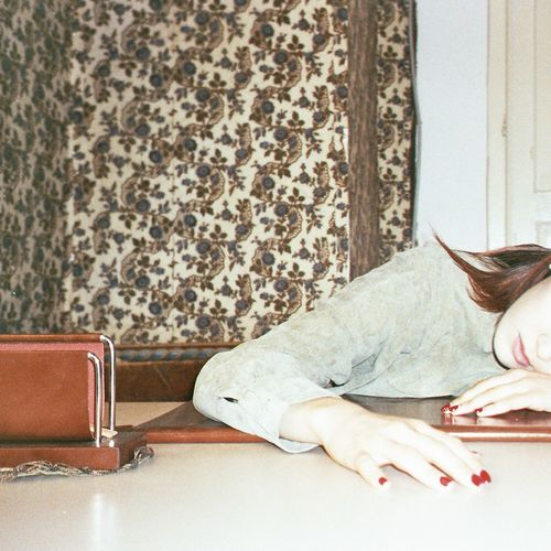 Woman sleeping on sofa at home