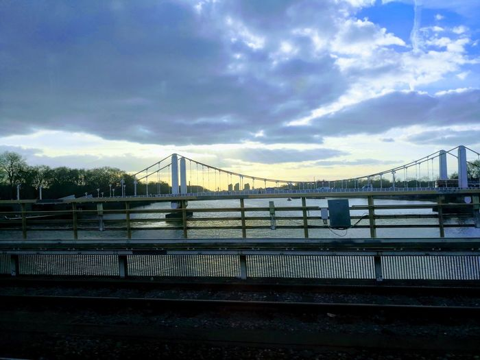 Bridge to a view Autoawesome Mate 10 Pro City Cityscape Urban Skyline Water Suspension Bridge Bridge - Man Made Structure Sunset River Sky Architecture Cable-stayed Bridge Bridge Engineering Steel Cable