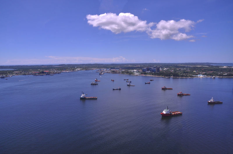 High angle view of boats in calm blue sea