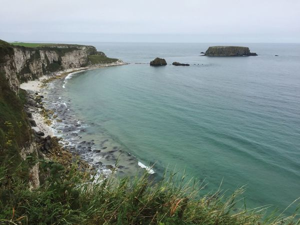 Schön hier. Northern Ireland Coastline Tranquil Scene Horizon Over Water Cliff Seascape Tranquility Coastline Shore Irish Sea Nature Grass Water Beauty In Nature Idyllic Remote Solitude Scenics