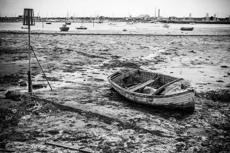 A Battered Old Boat Rests on the Bed of Langstone Harbour. Boat Harbour Harbour View Langstone Harbour  Decay HDR B&w Hampshire