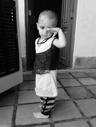 Full length portrait of girl standing